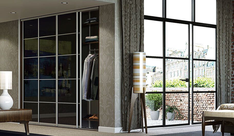Visby sliding wardrobe with black classic doors and décor bars